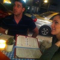 Photo taken at Montifiori Café by Greg R. on 6/5/2013
