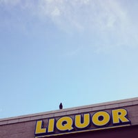 Photo taken at Liquor and Tobacco by Eryn T. on 12/7/2013