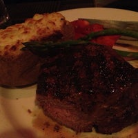 Photo taken at The Keg Steakhouse by Peter A. on 12/19/2012