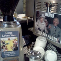 Photo taken at Cafe International by JD C. on 11/29/2012