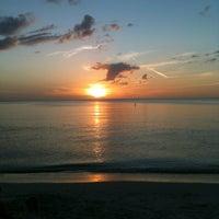 Photo taken at Bonita Beach by Ricardo M. on 12/15/2012
