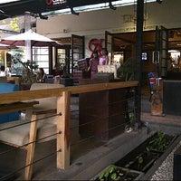 Photo taken at Green Cafe & Resto by Kim B. on 10/4/2012