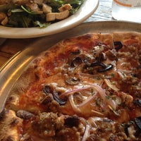 Photo taken at Bartolotta's Pizzeria Piccola by Matt T. on 6/8/2012