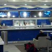 Photo taken at Delta Sky Club by Brandon F. on 3/10/2012
