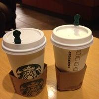 Photo taken at Starbucks by Phatnaree L. on 3/31/2012
