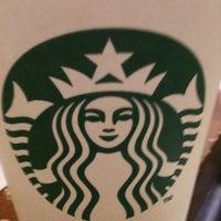 Photo taken at Starbucks by Erin M. on 9/7/2011