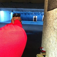 Photo taken at The Bullet Hole by Whitney P. on 4/13/2012