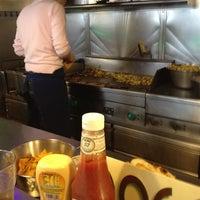 Photo taken at Dog's Café by Julien P on 2/25/2012
