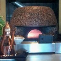 Photo taken at DOUGH Pizzeria Napoletana by Kristen D. on 7/31/2012