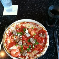 Photo taken at Brixx Wood Fired Pizza by Rachel H. on 6/17/2012
