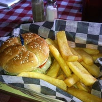 Photo taken at Huey's Restaurant by Wesley S. on 7/14/2012