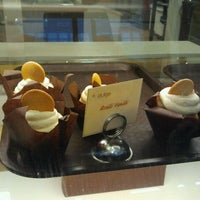 Photo taken at Indulge Cupcake Boutique by Tria W. on 12/18/2011