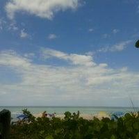 Photo taken at Vanderbilt Beach by Sheri B. on 4/9/2012