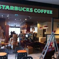 Photo taken at Starbucks by ilker on 12/20/2011