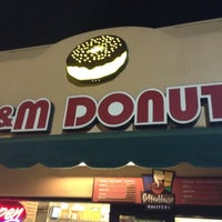 Photo taken at M&M Donuts by Jon D. on 8/6/2012