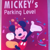 Photo taken at Mickey & Friends Parking Structure by Danny R. on 8/18/2012