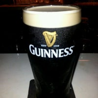 Photo taken at Malones Irish Restaurant & Bar by Edwin N. on 12/5/2011