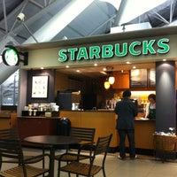 Photo taken at Starbucks Coffee 関西国際空港エアサイド店 by Natee P. on 4/30/2012