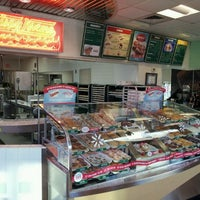 Photo taken at Krispy Kreme Doughnuts by beaux s. on 12/4/2011