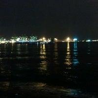 Photo taken at West Coast Beach by Kok Yong E. on 11/5/2011