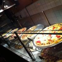 Photo taken at O Pedaço da Pizza by Marcio L. on 4/28/2012