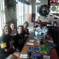 Photo taken at JJ Muggs Stadium Grill by Trevor M. on 12/24/2011