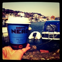 Photo taken at Caffé Nero by Burcu C. on 3/25/2012