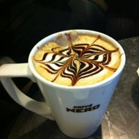 Photo taken at Caffé Nero by Ece C. on 11/27/2011