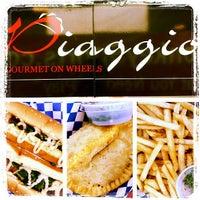 Photo taken at Piaggio Gourmet on Wheels by Albert E. on 10/22/2011