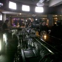 Photo taken at District Bar by April B. on 11/11/2011