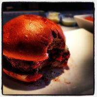Photo taken at Umami Burger by Christopher G. on 8/8/2012