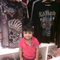 Photo taken at Ed Hardy by Izza N. on 12/24/2011