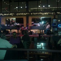 Photo taken at Blue Moon Piano Bar by Andres A. on 12/9/2011