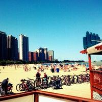 Photo taken at Oak Street Beach by Hellen M. on 8/11/2012