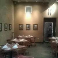 Photo taken at Rue Cler Restaurant and Bakery Cafe by Bill M. on 11/26/2011