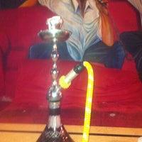 Photo taken at Eastown Hookah Lounge by Martha D. on 3/8/2012