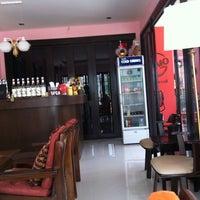 Photo taken at Lomo Cafe'' by Thanitsara S. on 2/26/2012