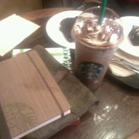 Photo taken at Starbucks Coffee by Harry N. on 12/10/2011