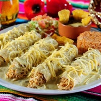Photo taken at Totopos Gastronomia Mexicana by gabriela b. on 5/18/2011