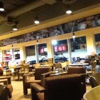 Photo taken at Starbucks by Atlanta Exclusive limo on 12/12/2011