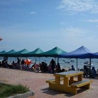 Photo taken at Pantai Teluk Kemang by Syed Ashraf A. on 9/10/2011