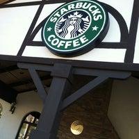 Photo taken at Starbucks by Dollie P. on 1/1/2012