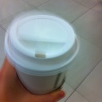 Photo taken at Starbucks by Juliana F. on 8/4/2012