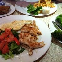 Photo taken at New Venus Restaurant by Darren R. on 7/2/2012