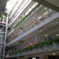 Photo taken at Centro Comercial Oasis Center by Jenny R. on 6/15/2012