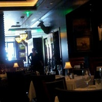 Photo taken at The Capital Grille by Mônica G. on 7/15/2012