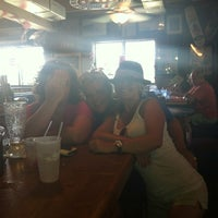 Photo taken at Sandbar Sports Grill by Kat Rylee S. on 7/2/2012