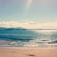 Photo taken at Praia de Laranjeiras by Francisco D. on 7/9/2012