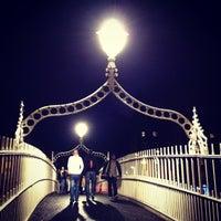 Photo taken at The Ha'penny (Liffey) Bridge by Jérôme T. on 7/28/2012