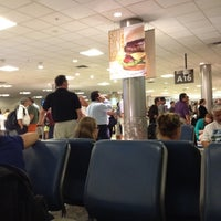 Photo taken at Concourse A by Chely D. on 8/7/2012